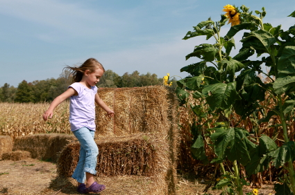 Girl on Hay bales